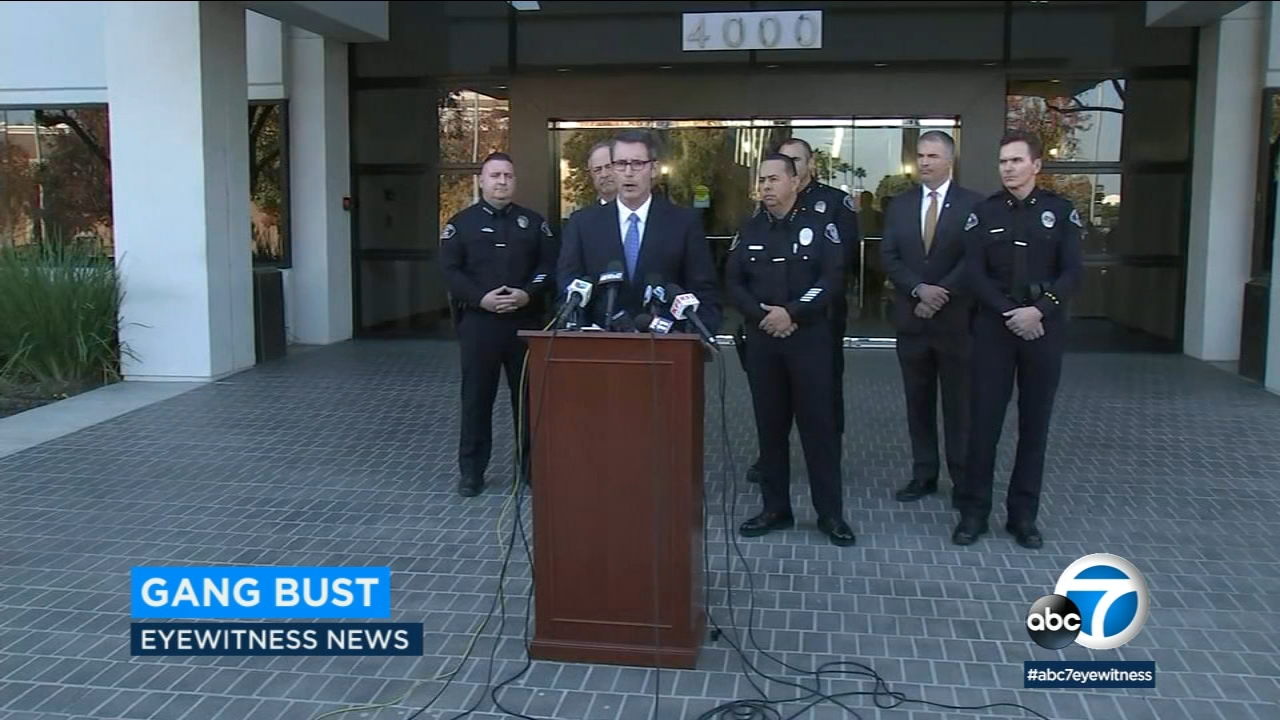 FBI agents and Orange County police announced indictments against 20 suspects on drug and weapons charges.
