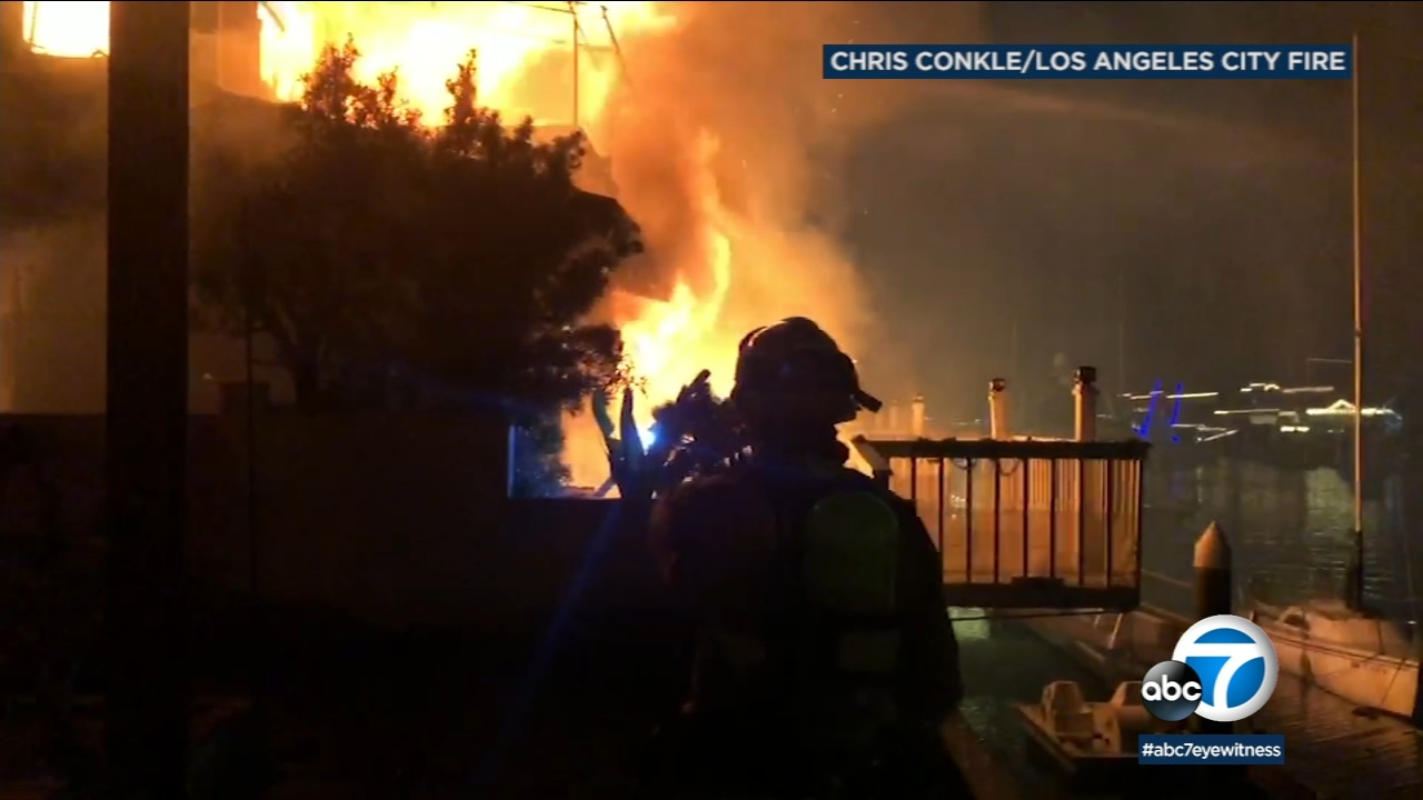 A home in Huntington Beach is seen engulfed in flames on Dec. 13, 2018.
