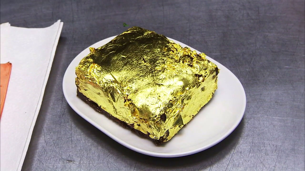 A gold leaf-covered brownie worth $500 is shown a photo.