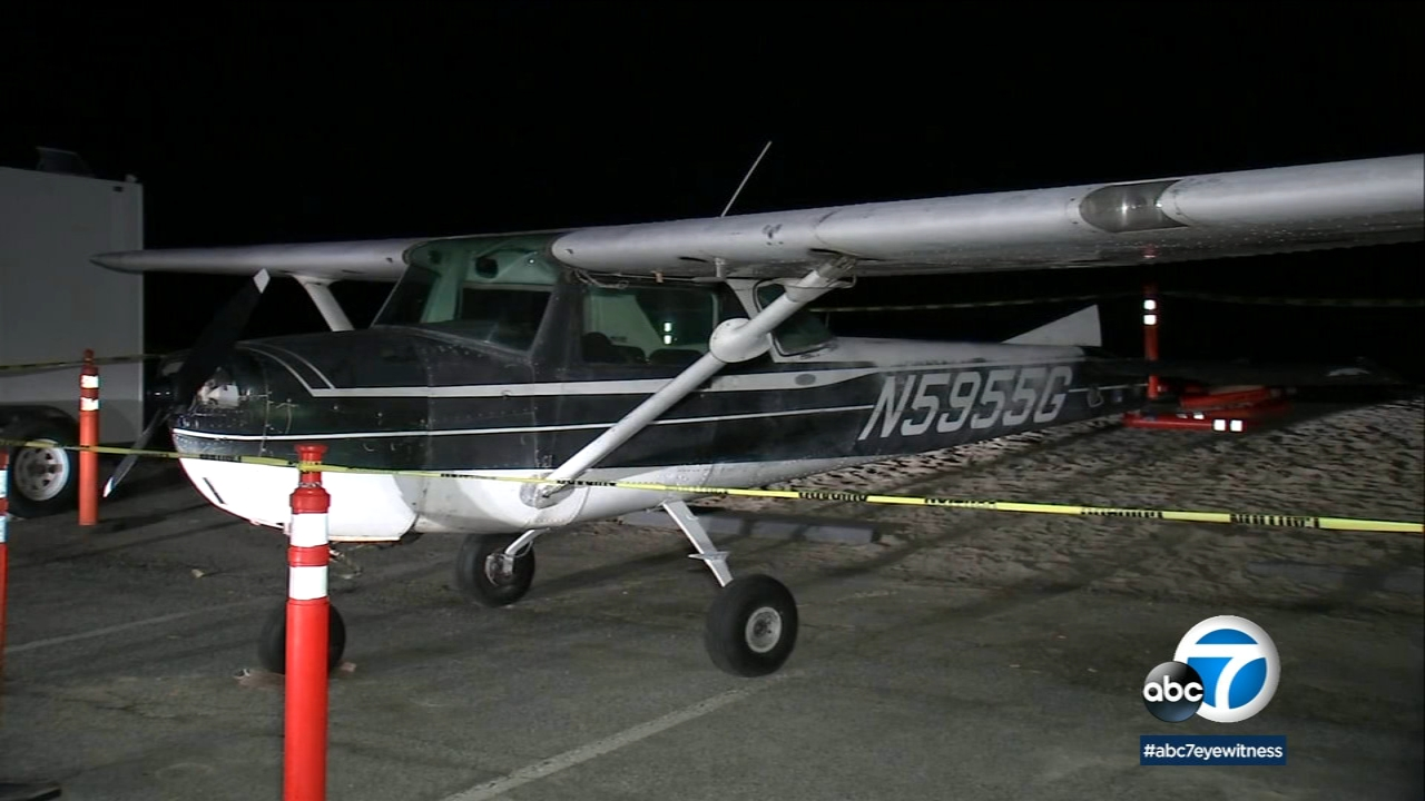A photo shows a small plane that made an emergency landing on a beach in Dana Point on Saturday, Dec. 15, 2018.