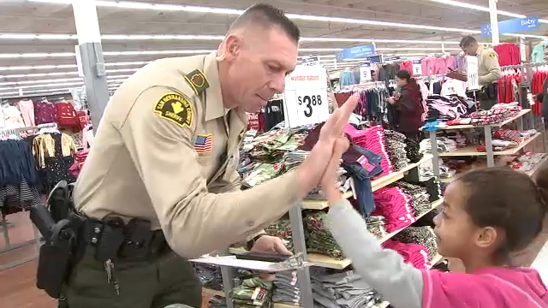 Children from all over San Bernardino County got to buy Christmas gifts for their families and other items at Walmart as part of a Shop With a Cop event.