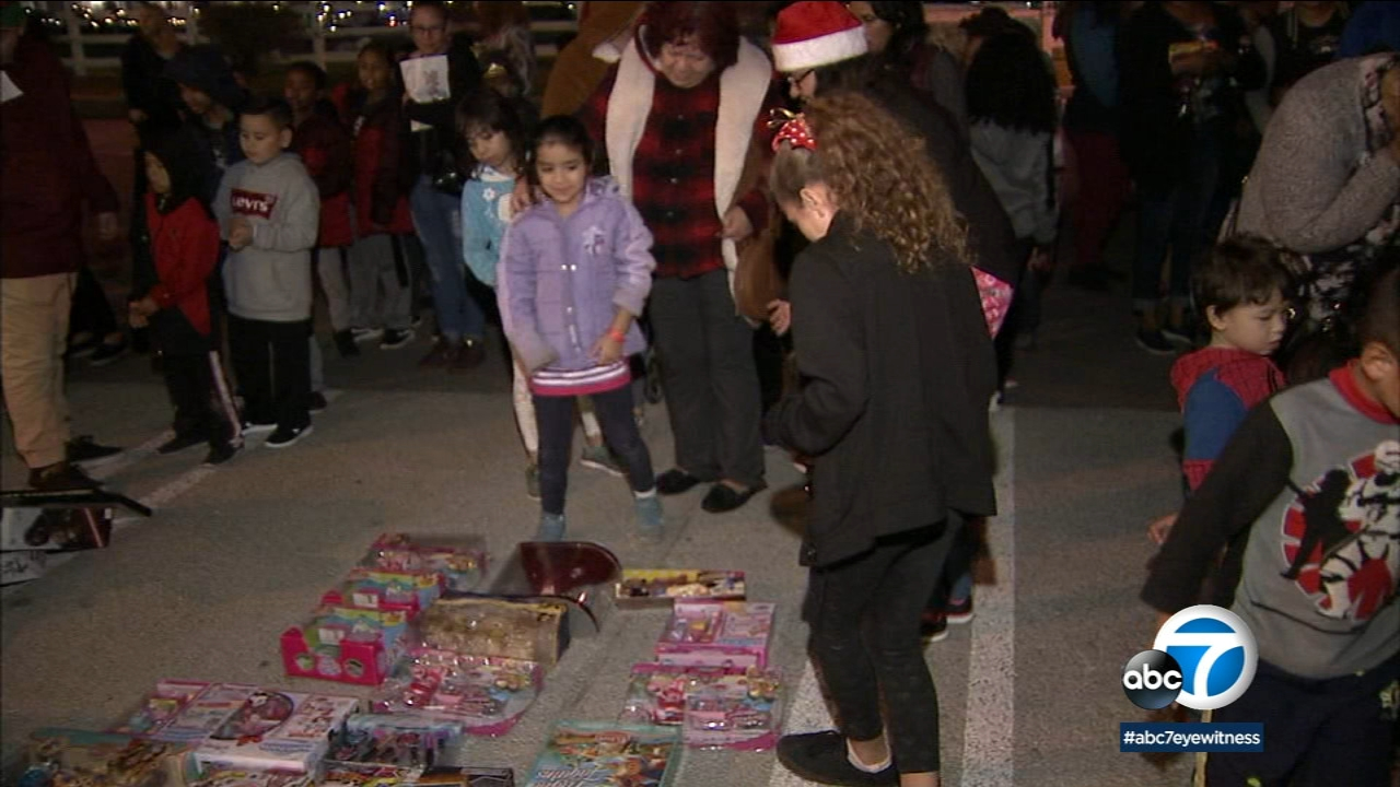 Los Angeles firefighters handed out donated gifts in Porter Ranch to families in need thanks to the Spark of Love toy drive.