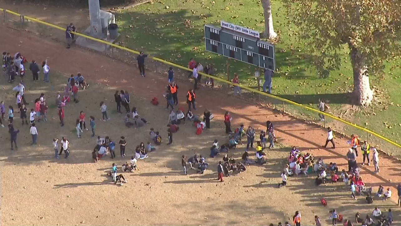 Students wait outside a Glendale school where a bomb threat was called in.