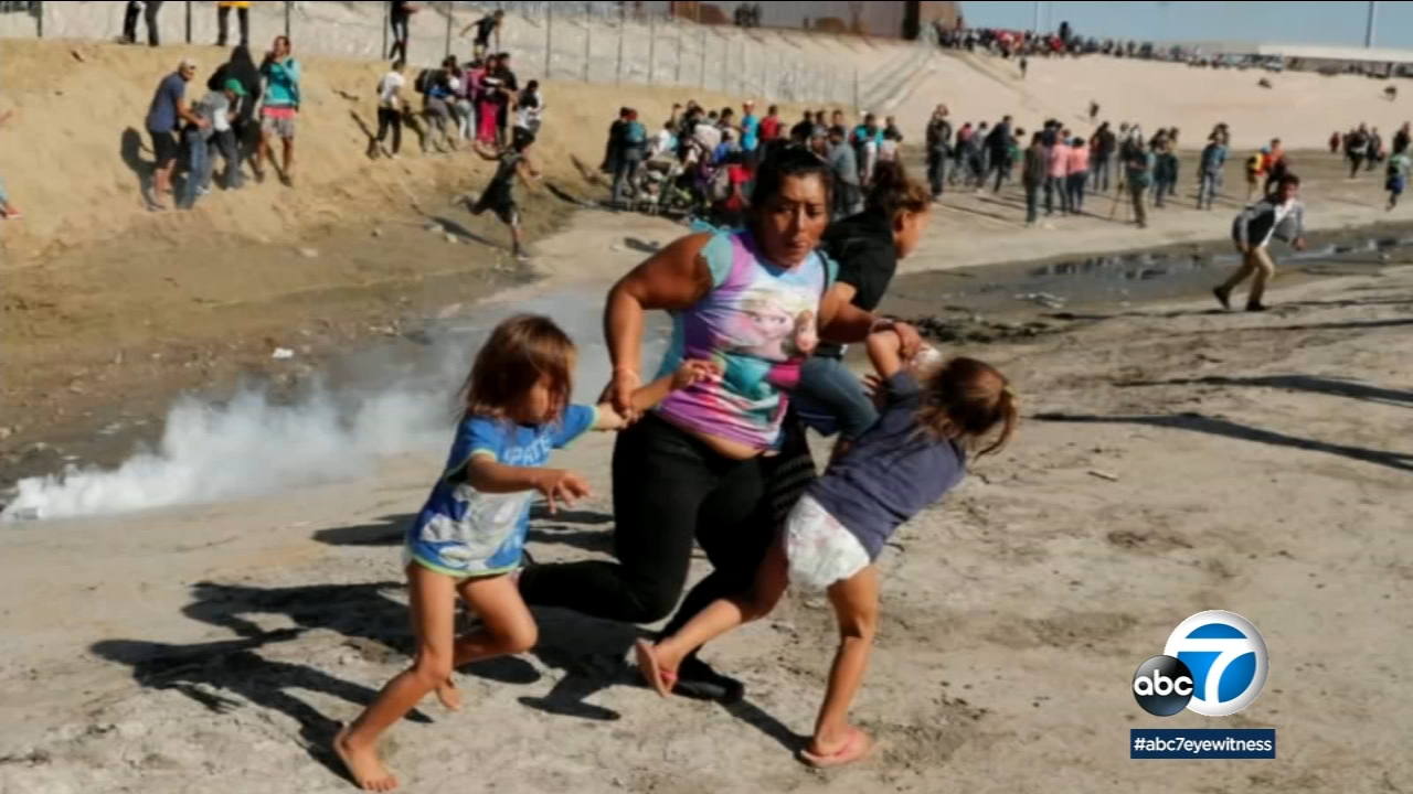 Maria Meza, 39, is seen running away from tear gas with her children near the U.S.-Mexico border.