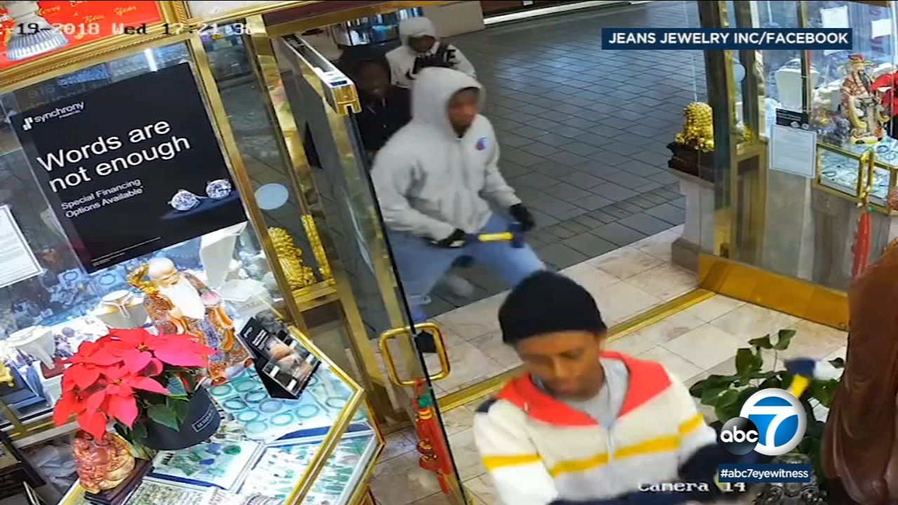 Alarming video shows a group of robbers barging into a Westminster jewelry store and taking sledgehammers to the cases on Wednesday, Dec. 19, 2018.