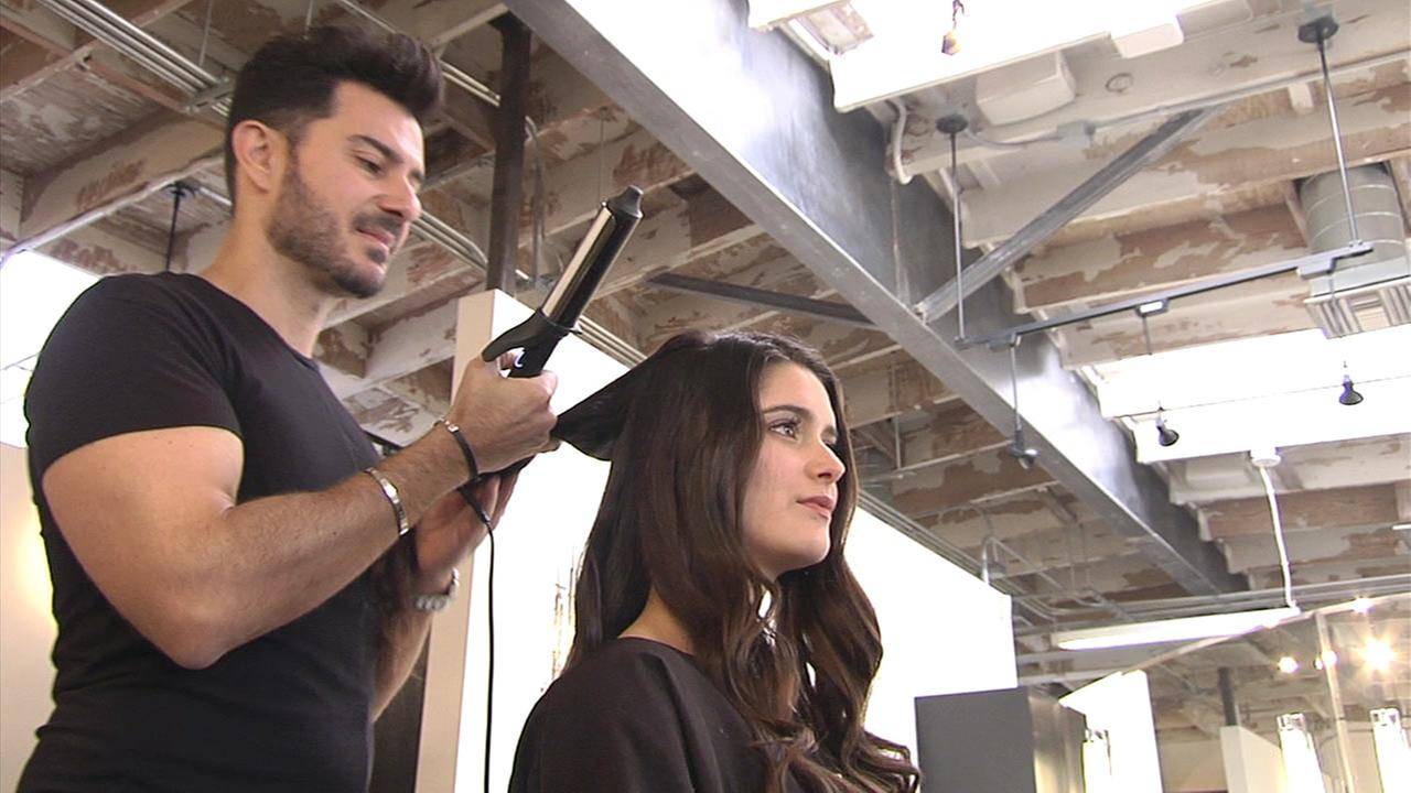 Celebrity hair stylist George Papanikolas styles a models hair in this file photo.
