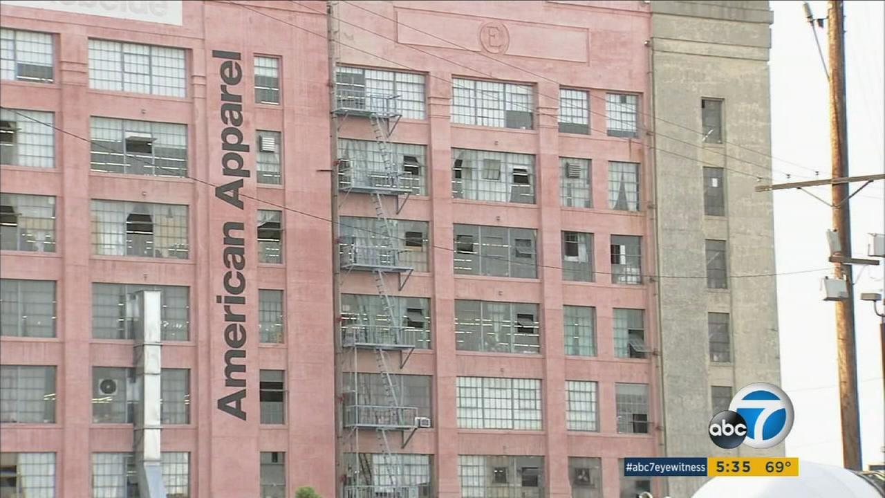 Workers walked off the job at American Apparel in protest of layoffs and salary cuts on Friday, Feb. 26, 2016.