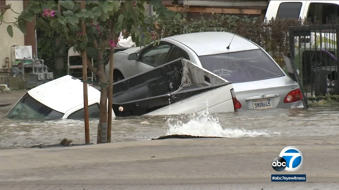 A South L.A. street turned into a lake after a 24-inch cast iron pipe burst on Friday, Dec. 21, 2018.