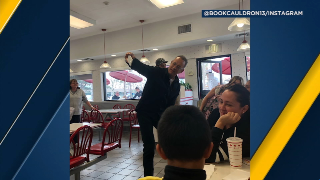 Tom Hanks takes a selfie with some fans at a Fontana In-N-Out.