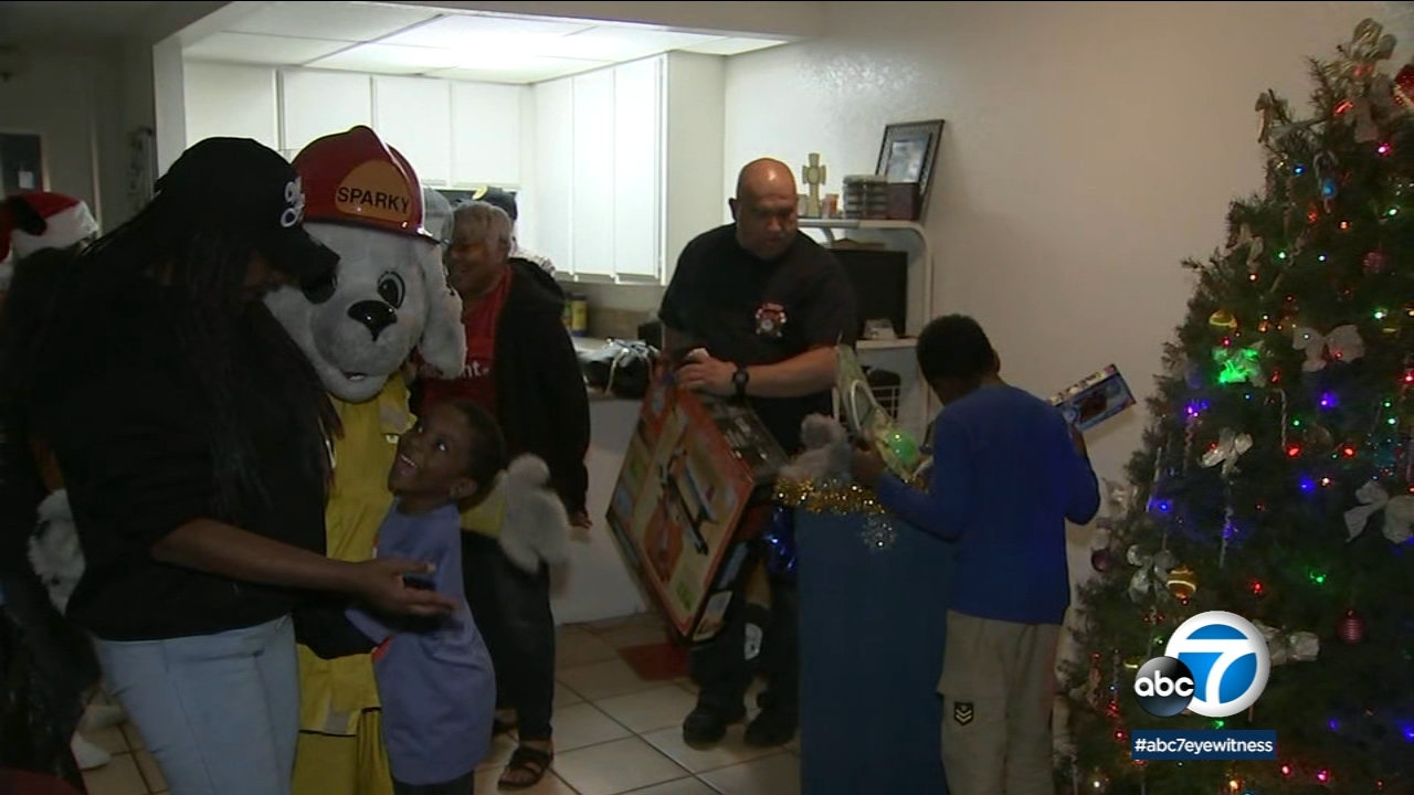 Firefighters and ABC7s Spark of Love helped bring some Christmas cheer to a Long Beach woman who is struggling with breast cancer.