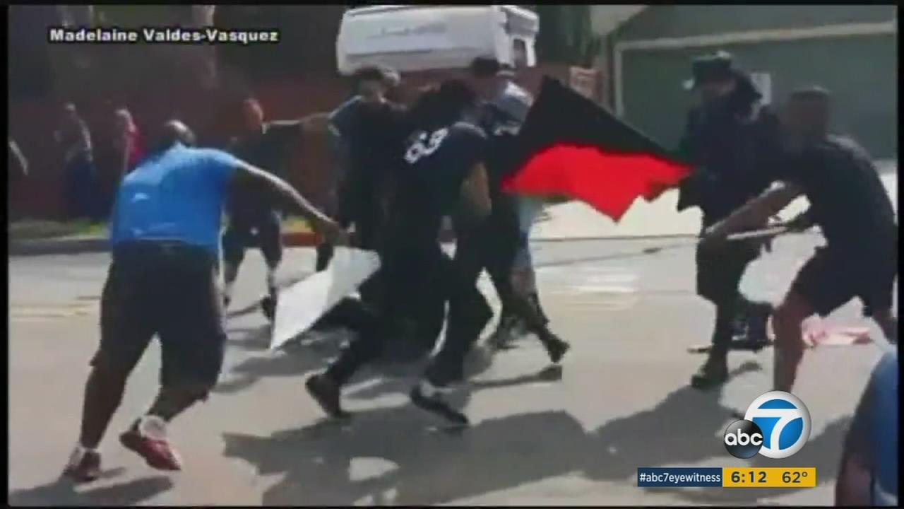 Video shows a KKK member being kicked in the head by a counter-protester during a rally in Anaheim.