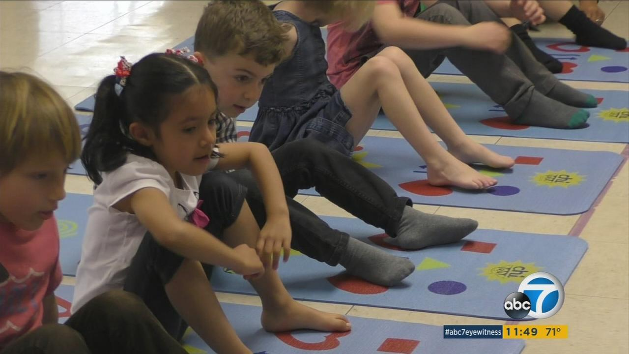 Children participate in Chi Universe, a yoga game invented by fitness expert Bobbi Hamilton.