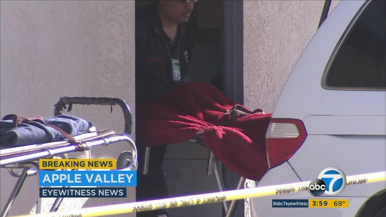 A body is being wheeled out in Apple Valley.