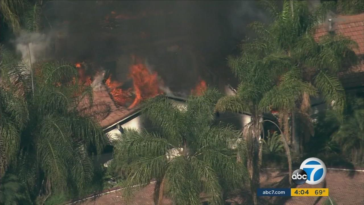 A house erupted in flames during a standoff with a barricaded suspect in Chino Wednesday morning.