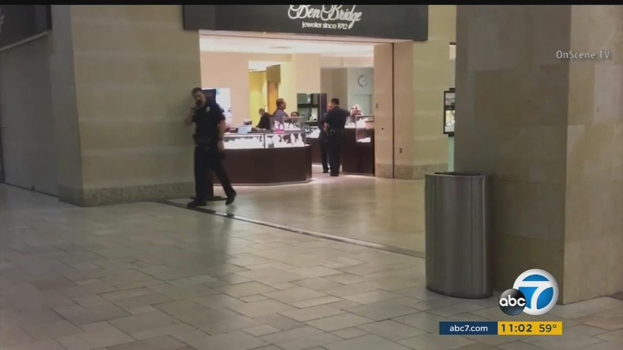 Police said four suspects armed with a gun and hammers robbed the Ben Bridge Jeweler store in Westfield Topanga mall on Wednesday, March 9, 2016.