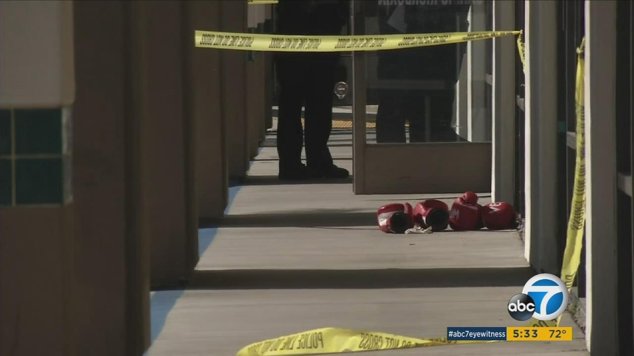 A pair of gloves are shown in the doorway of a boxing gym in Tustin after a man was killed inside on Thursday, March 24, 2016.