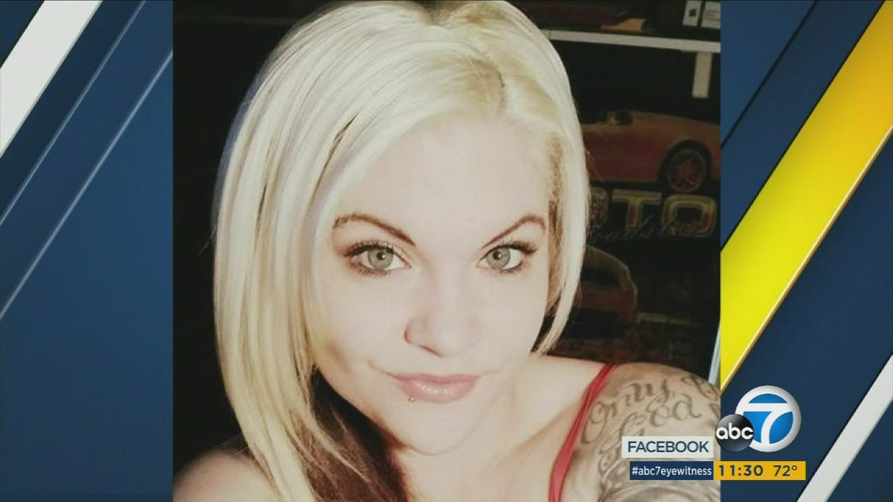 A woman who was shot by her ex-boyfriend during a police standoff in Redlands is still fighting for her life.