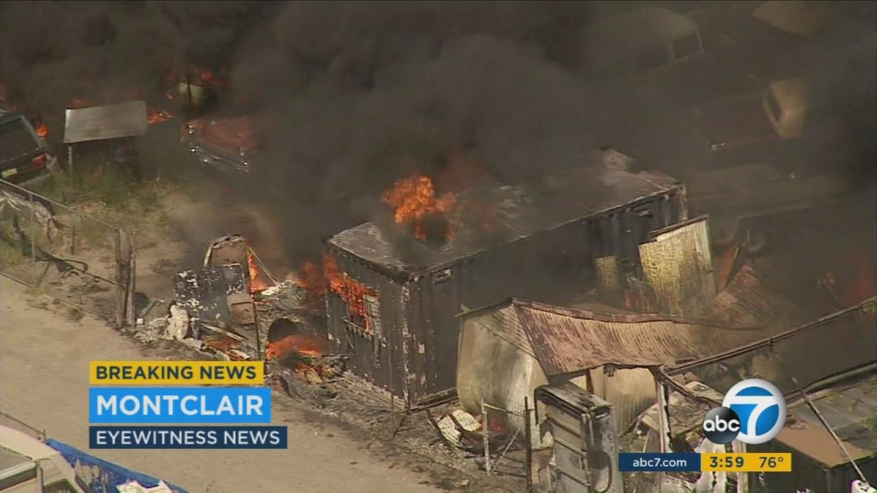 A fire is seen burning at a recycling center in Montclair, Calif., on Monday, April 4, 2016.