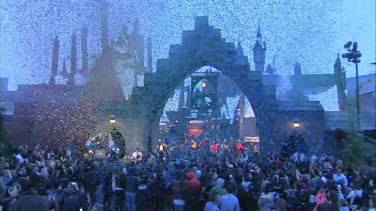 A huge crowd gathers at the entrance of the Wizarding World of Harry Potter at Universal Studios Hollywood on opening day, Thursday, April 7, 2016.