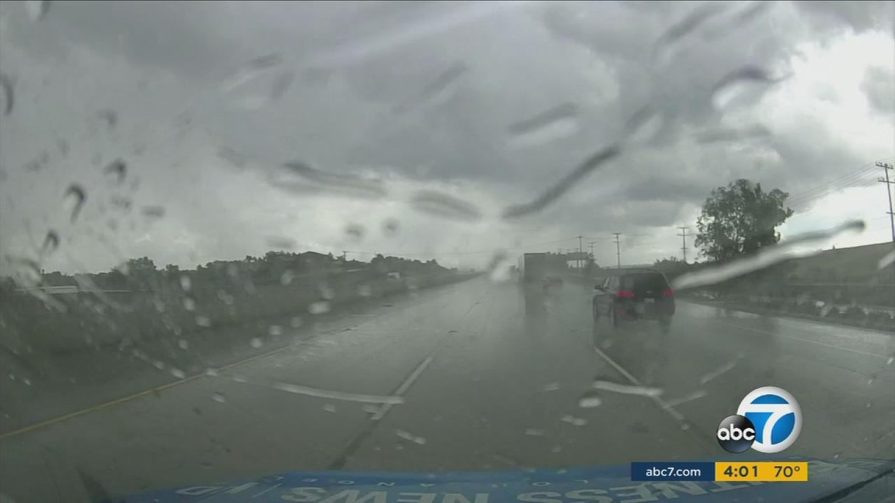 Dark and stormy clouds brought in heavy downpours in the Inland Empire and created risky driving conditions for motorists in the area.