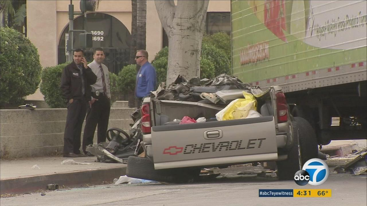 A pick-up truck was smashed under a big rig in Vernon in a fatal crash on Saturday, April 30, 2016.