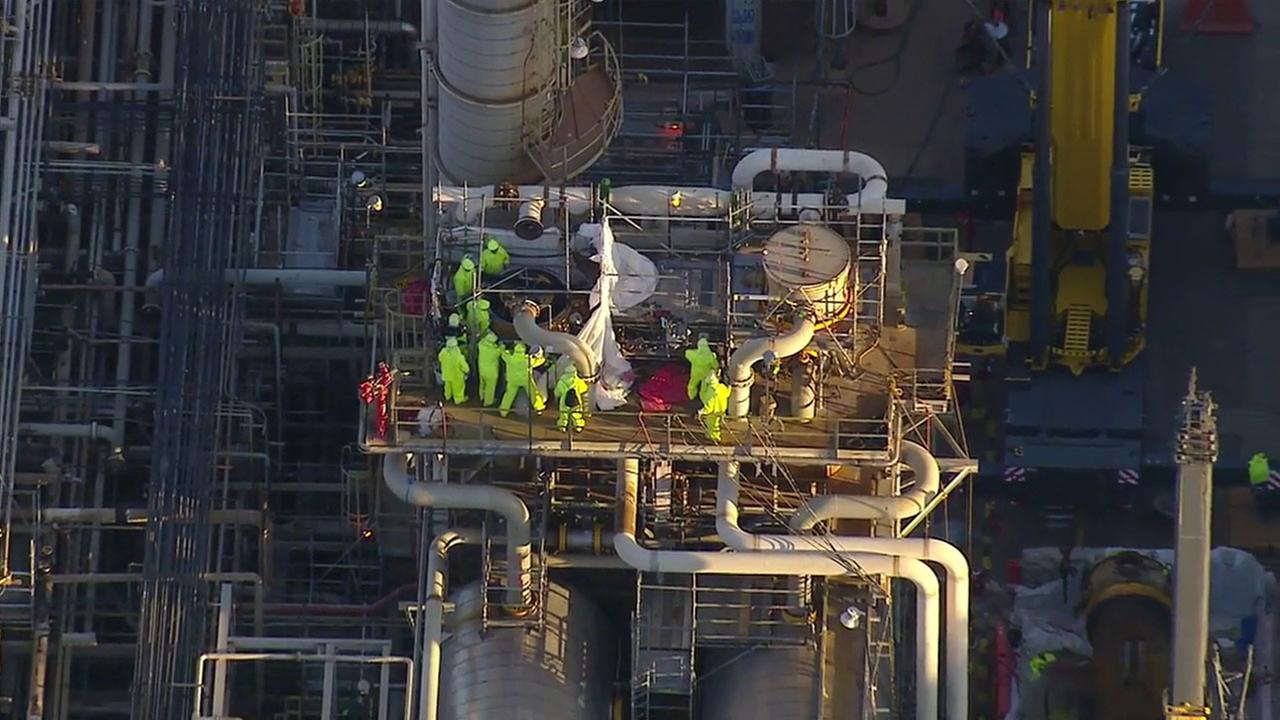 Crews prepare to restart operations at the Torrance ExxonMobil refinery.