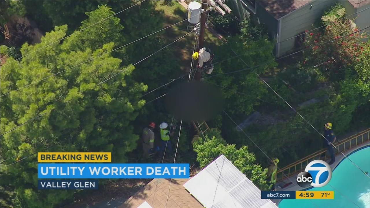 A utility worker died after being found dangling from a power pole in Valley Glen Friday, May 13, 2016.