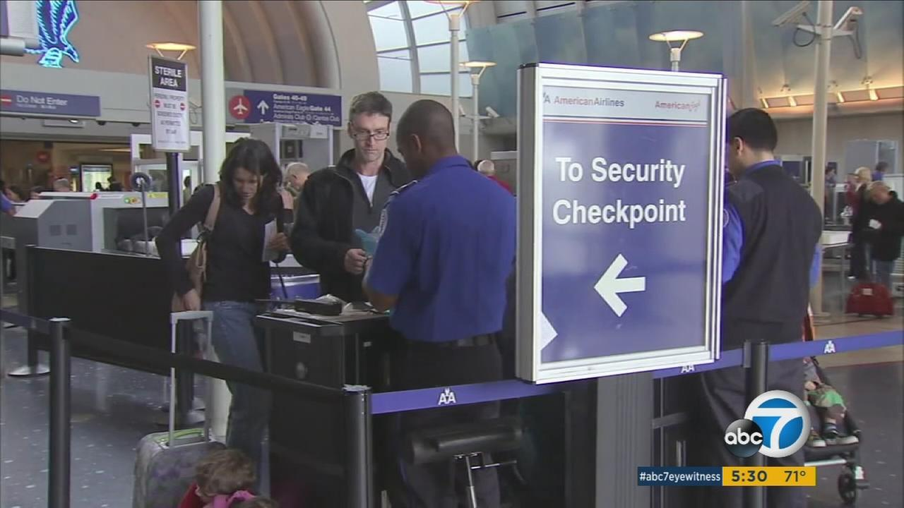 People are seen waiting in long lines at a TSA checkpoint at  Los Angeles International Airport in an undated photo.