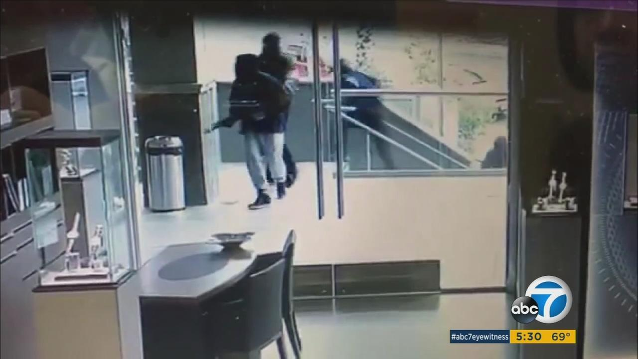 Surveillance video shows would-be robbers in a shootout with guards at a jewelry store in Rowland Heights.