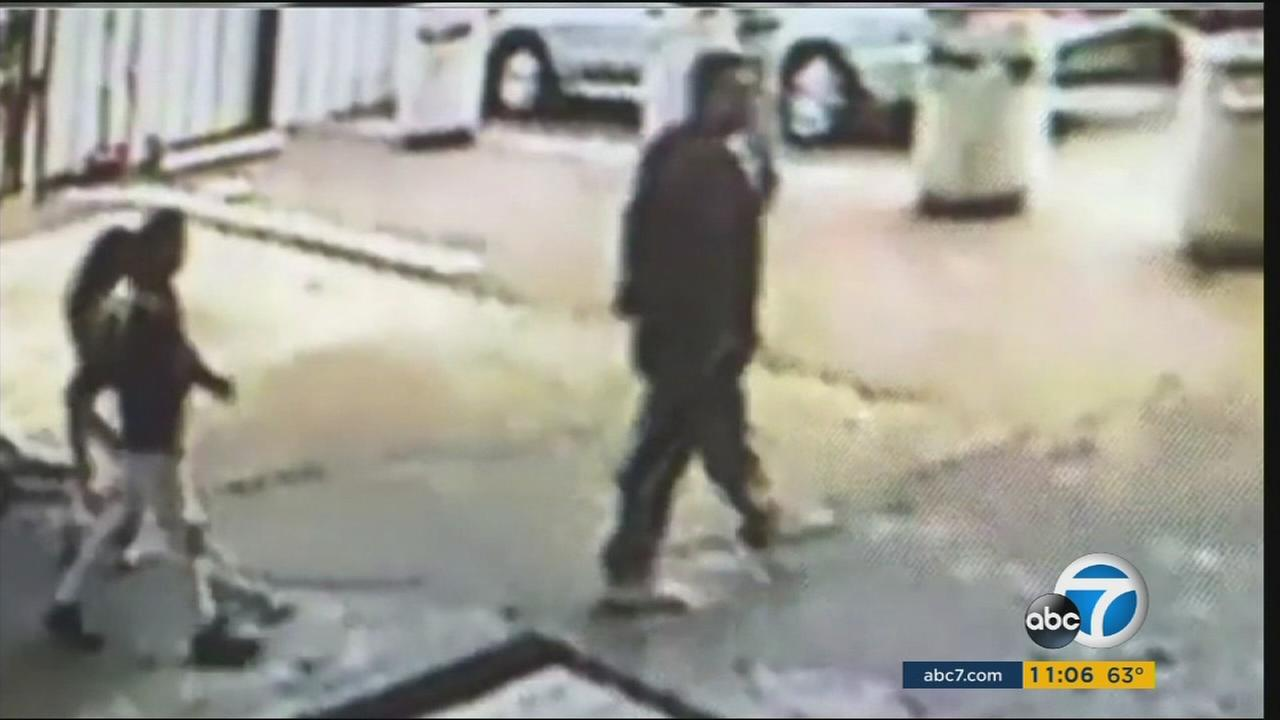 Surveillance video captured a father purportedly instructing his children to steal from a car wash in El Sereno.