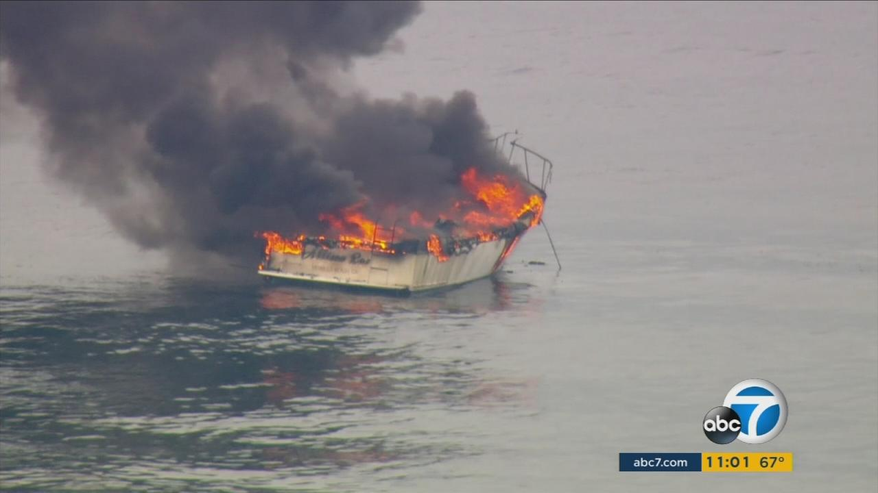 A boat is seen engulfed in flames about a mile off the coast of Malibu on Tuesday, May 17, 2016.