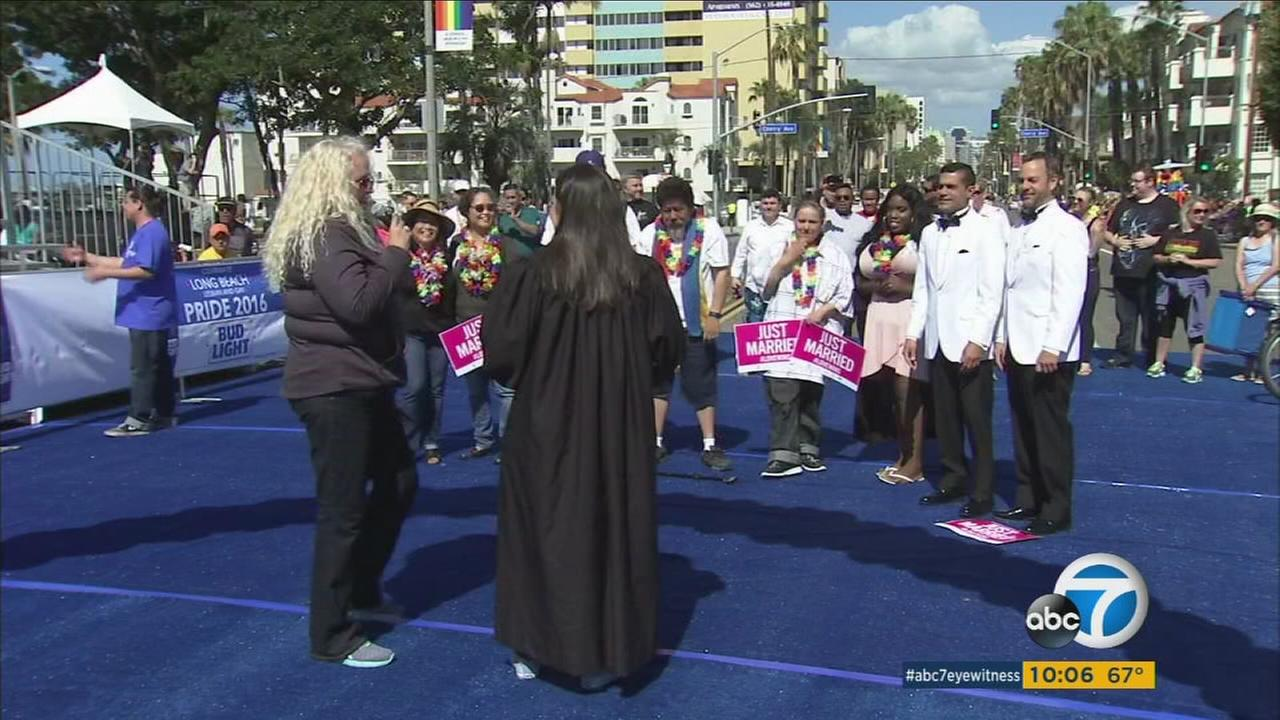 A mass same-sex wedding ceremony kicked off this years Long Beach Lesbian and Gay Pride Parade on Sunday.