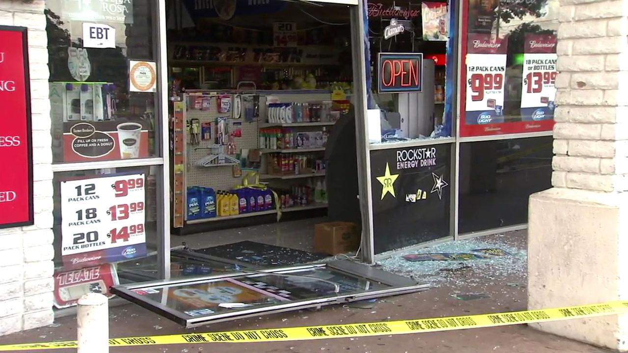 The smashed front doors and glass are scattered in front of a Garden Grove liquor store after a burglary in the early morning hours of Tuesday, May 24, 2016.