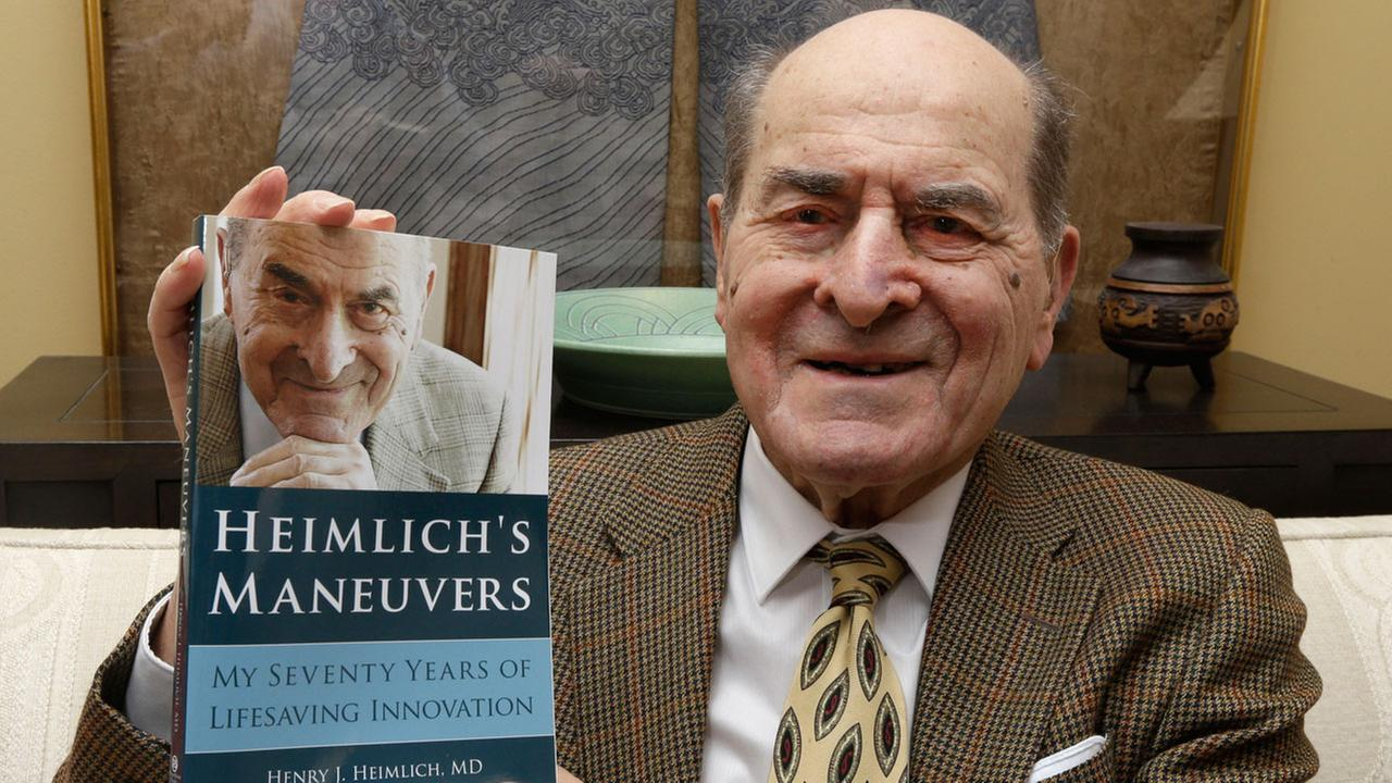 In this Wednesday, Feb. 5, 2014 photo, Dr. Henry Heimlich holds his memoirs prior to being interviewed at his home in Cincinnati.