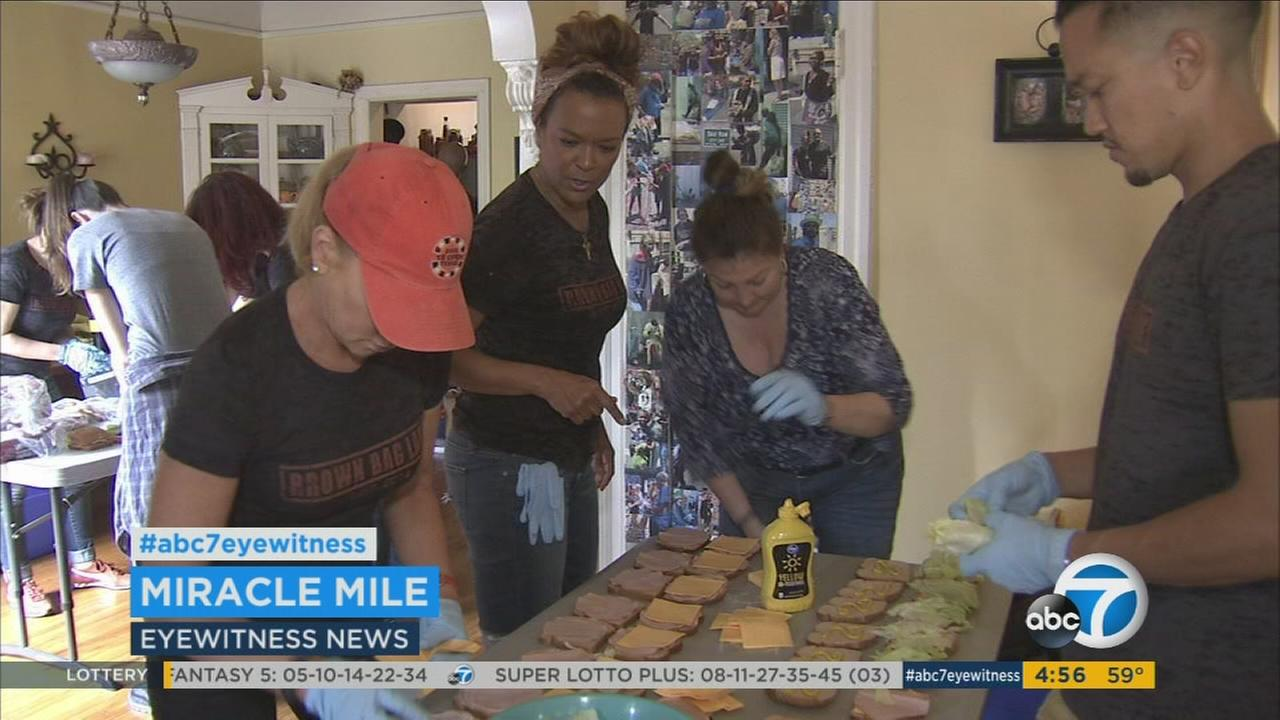 Single mom Jacqueline Norvell started out making brown bags of food and hygiene products for the needy on Skid Row and now has an army of volunteers helping out.