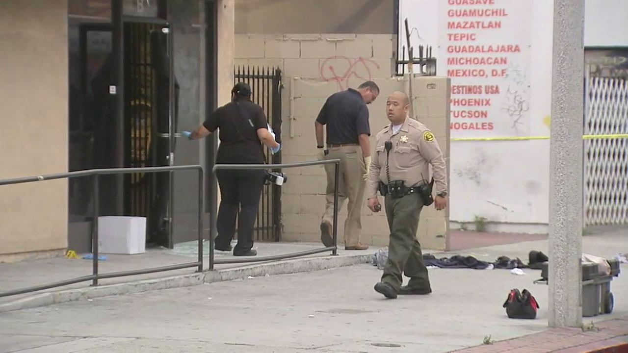 Los Angeles County sheriffs investigators look over the crime scene Wednesday, June 8, 2016, after a Walnut Park store owner shot two attempted robbers the night before.