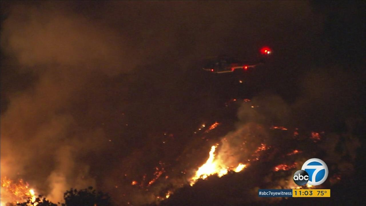Crews battled two raging brush fires in the Angeles National Forecast overnight as thousands of acres were scorched north of  Azusa and Duarte.