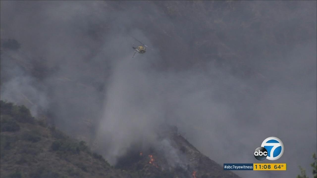 Air rescue crews dump water onto the San Gabriel Complex Fire Wednesday, June 22, 2016.