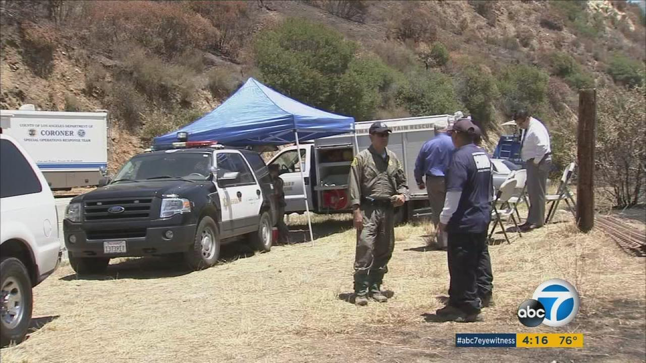 Coroners officials removed the remains of two charred bodies from the Angeles National Forest and will test to see if they are two hikers reported missing on June 20.