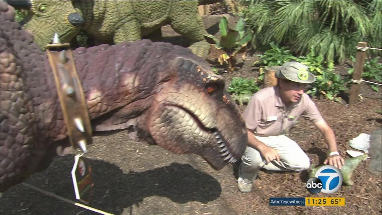 Baby dinosaurs were hatched at the Los Angeles Zoo as part of an animatronic exhibit that looks at connections between the prehistoric beasts and modern creatures.