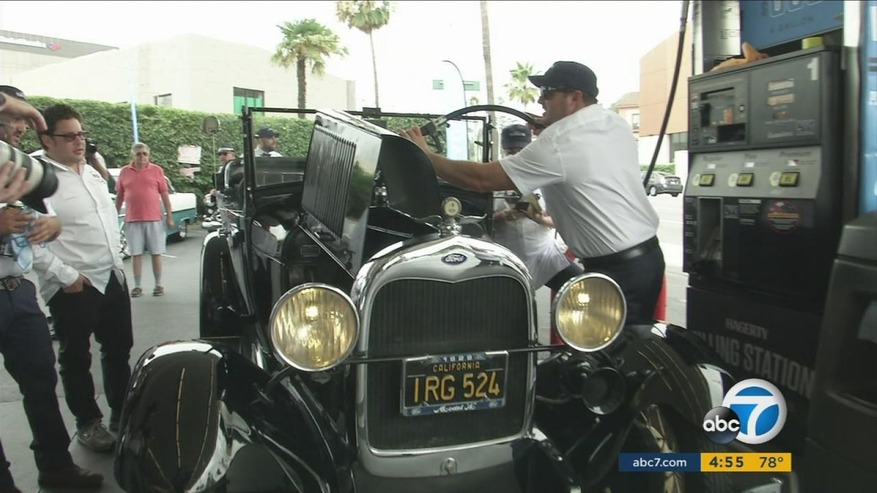 Classic cars were given the chance to fill up their tanks for prices from the year they were built at a Beverly Hills event to honor vintage vehicles.