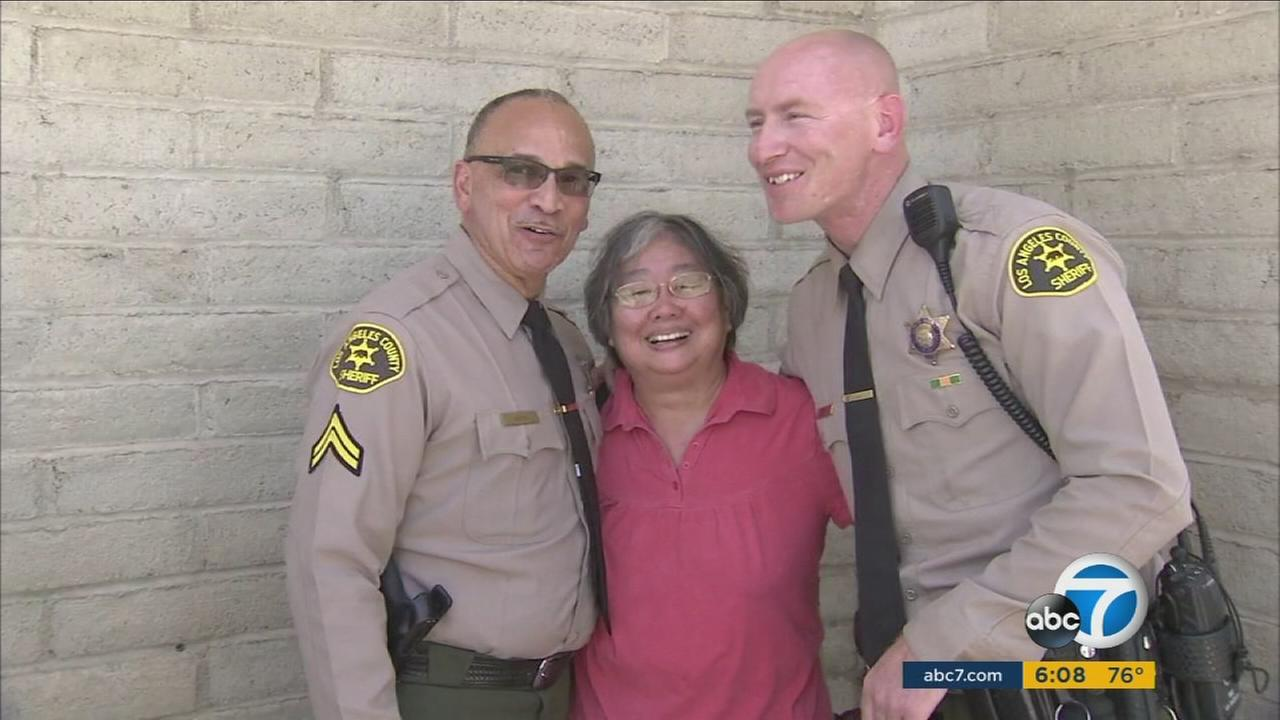 Marilyn Kishi hugged and thanked Los Angeles County sheriffs deputies Alex Smith and Shane Dobra after they rescued her from her burning Stevenson Ranch home.