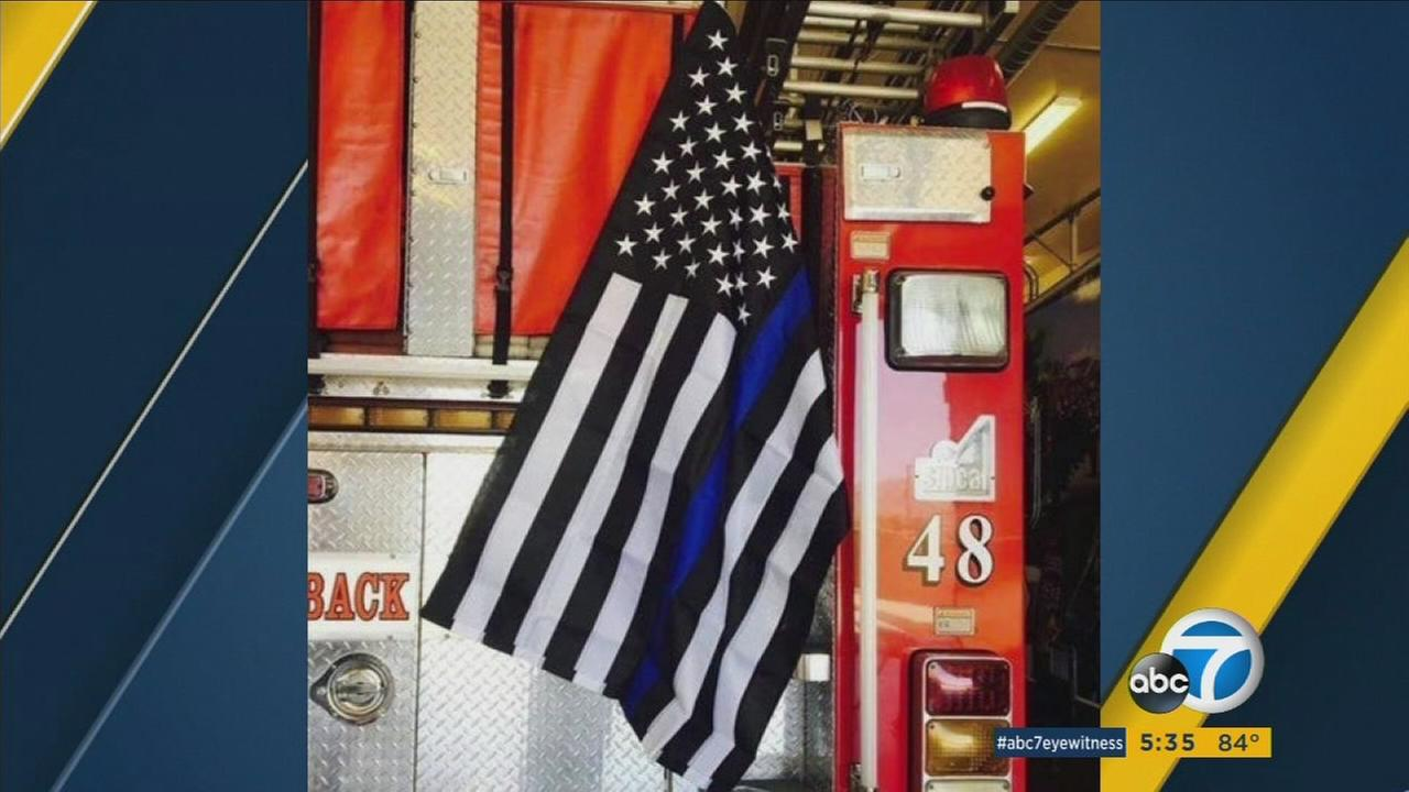 Veteran firefighter Eric Hille and fellow firefighters created American flags with a thin blue line to display on firetrucks to show support for fallen peace officers.
