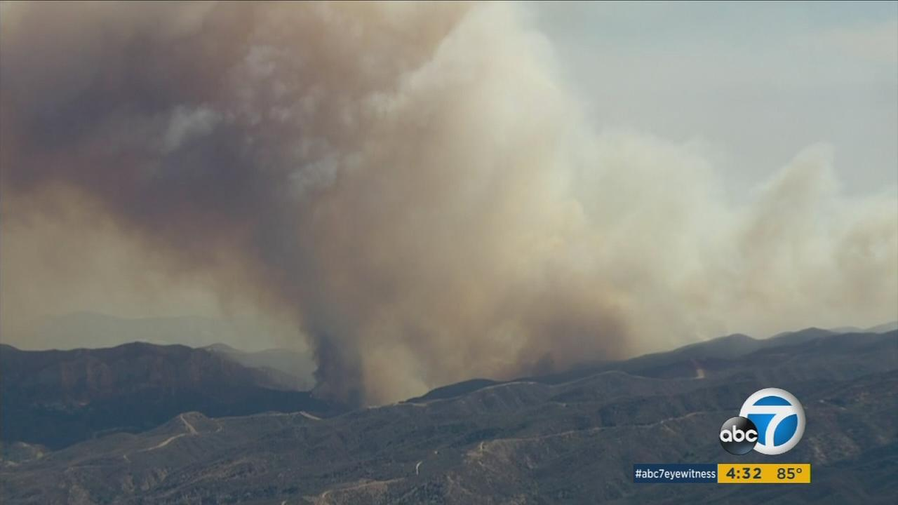 Air quality advisories for residents in Santa Clarita Valley, San Gabriel Valley and San Gabriel Mountains were issued Monday amid the fast-moving Sand Fire.