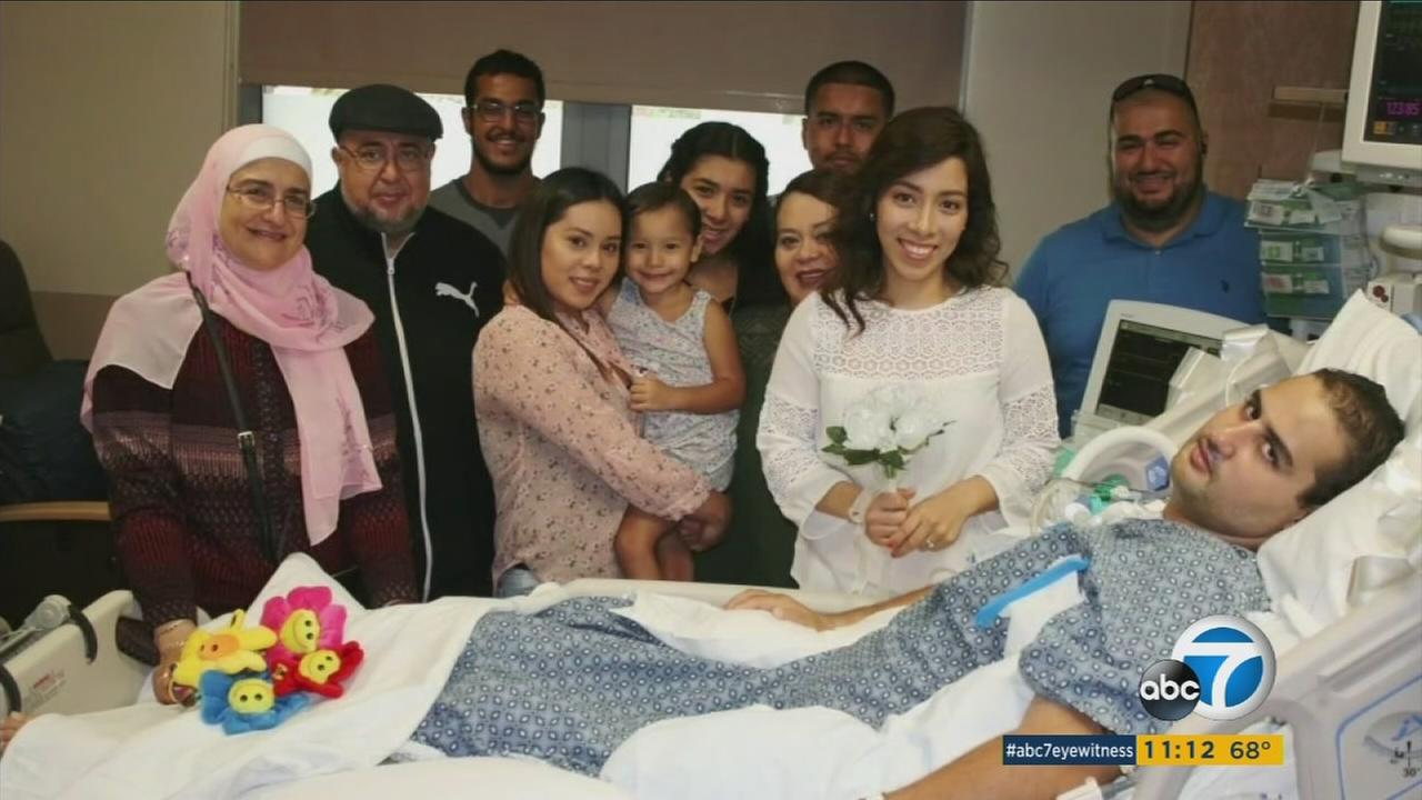 Omar and Osiris Elhosseiny and family members pose for a photo following the couples wedding in a hospital.