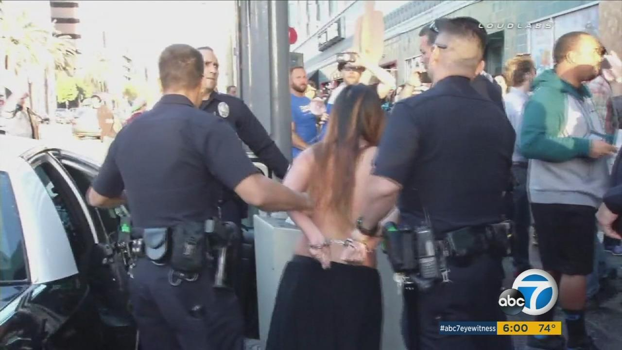 Anni Ma is seen getting arrested after going topless at a Bernie Sanders rally in Los Angeles.