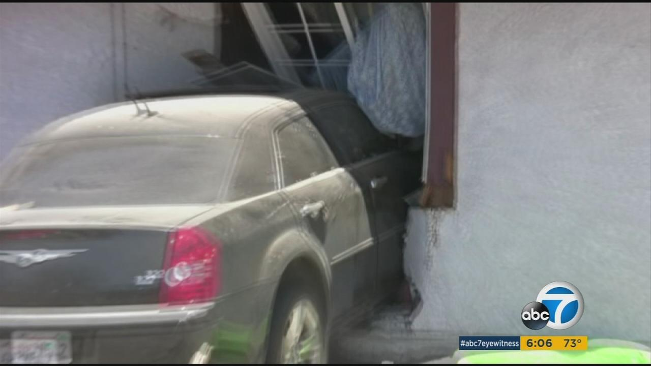 A car driven by an 8-year-old boy smashed into his neighbors house in Littlerock on Saturday, injuring one person, police said.