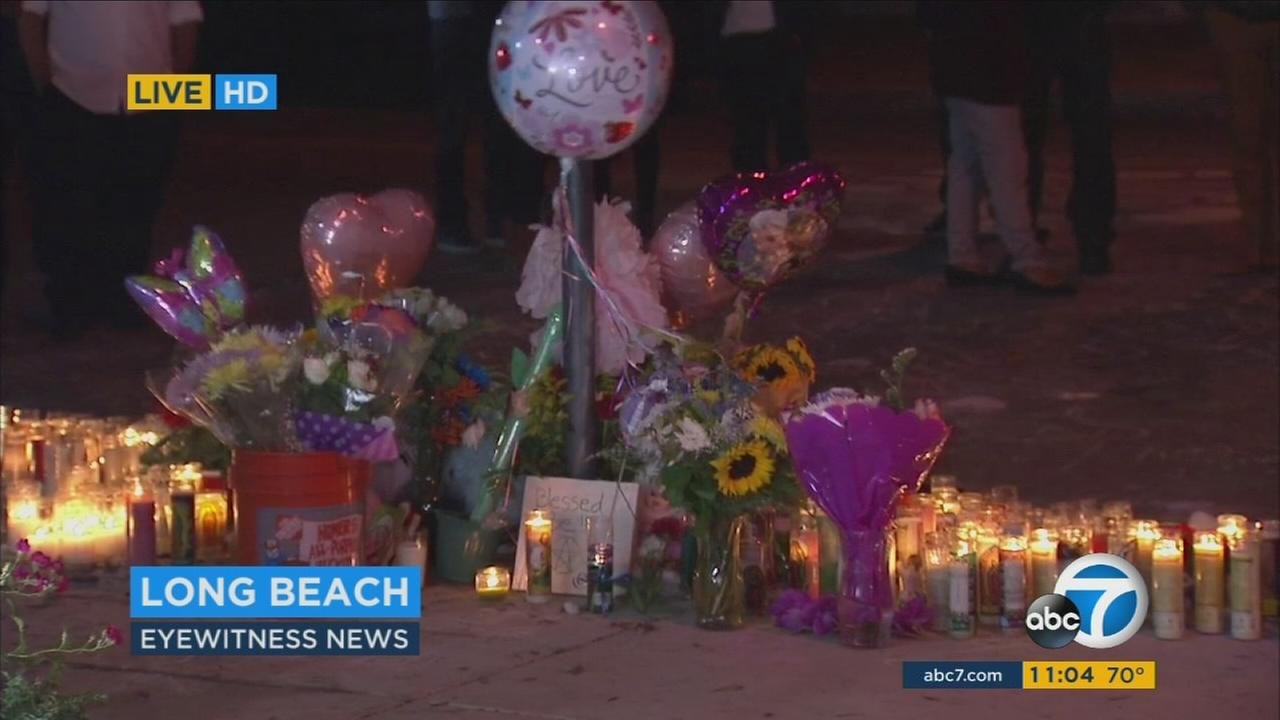 A memorial sits at the site where a mother and her daughter were shot to death in Long Beach.