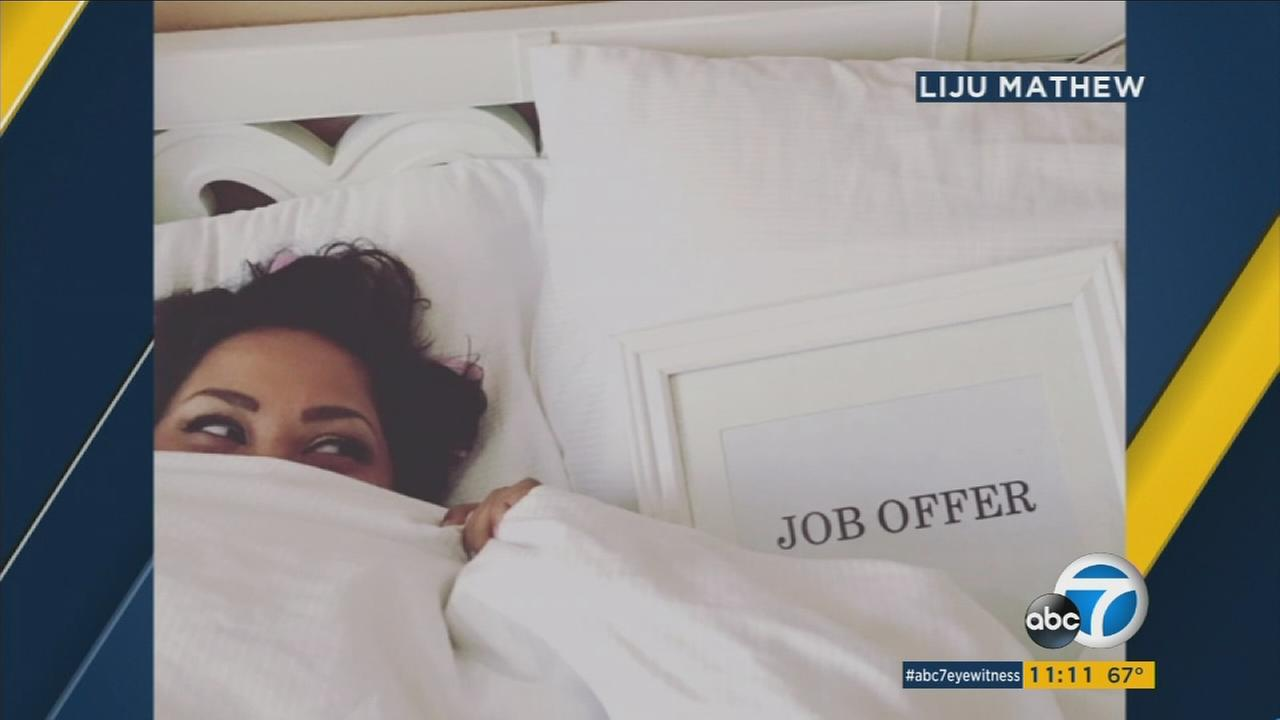 Benita Abraham poses in a cute engagement-style photo with her job offer letter in viral Facebook photos.