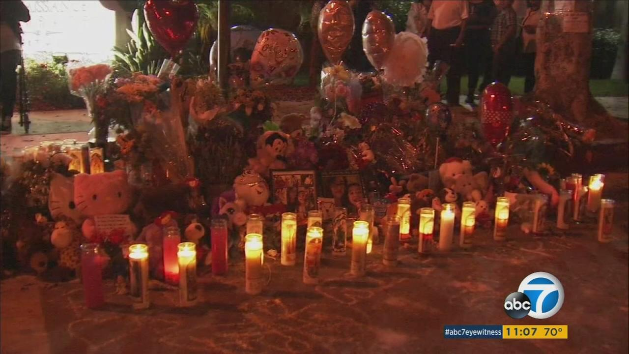 A memorial is set up at the site where a mother and her young daughter were gunned down in Long Beach. A candlelight vigil was held on Saturday, Aug. 13, 2016.